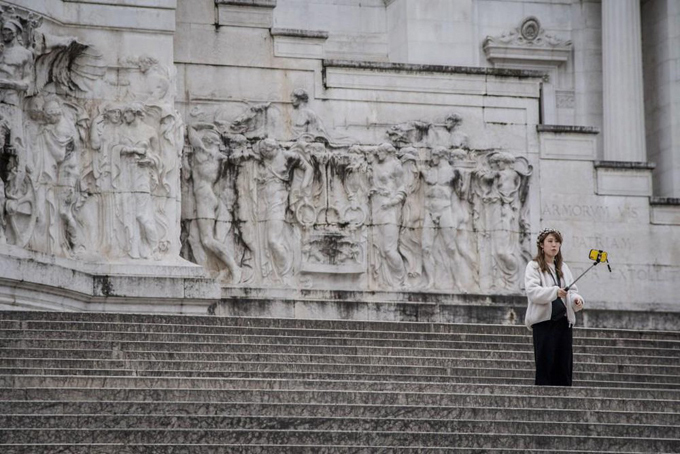 A single traveller is spotted taking a selfie on some steps in Rome